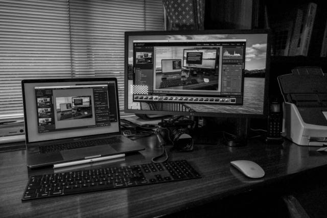 The current set-up at Macfilos: 15in MacBook Pro and 24in LG monitor (plus the ever-ready Leica Q2. Image: Leica Q2 Monochrom at ISO 6400
