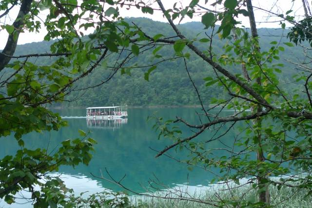 Ferry heading north on Kozjak lake. D-Lux 4 by Georgia Armstrong