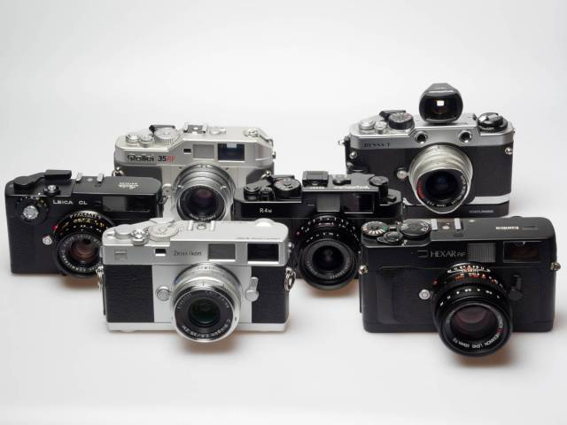 "Not quite M Leicas, but all fitted with an M lens mount and more or less interesting alternatives to Leica's M6 or Leica's current analogue models, the M-A and MP: The Zeiss Ikon and Konica Hexar RF (front row, from left); Leica CL and Voigtländer Bessa R4M (middle); Rollei 35 RF and Voigtländer Bessa T (back), each camera with the kit lens or or another lens from the same manufacturer. In a series of articles, Macfilos will review every one of these six cameras. They all have in common that they are the ""not-quite-M-Leicas""."