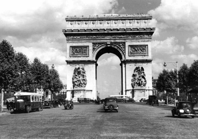The familiar outline of the Arc De Triomphe, which my father seems to have taken from the middle of the Avenue Champs D'Elysee
