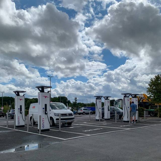 A familiar sight for EV owners. No more messy petrol or diesel, instead you jut plug it in like an electric fire. Here you see Ionity's new bank of chargers at the Cobham Service Centre on the M25 London periphery motorway. A cover would be welcome...