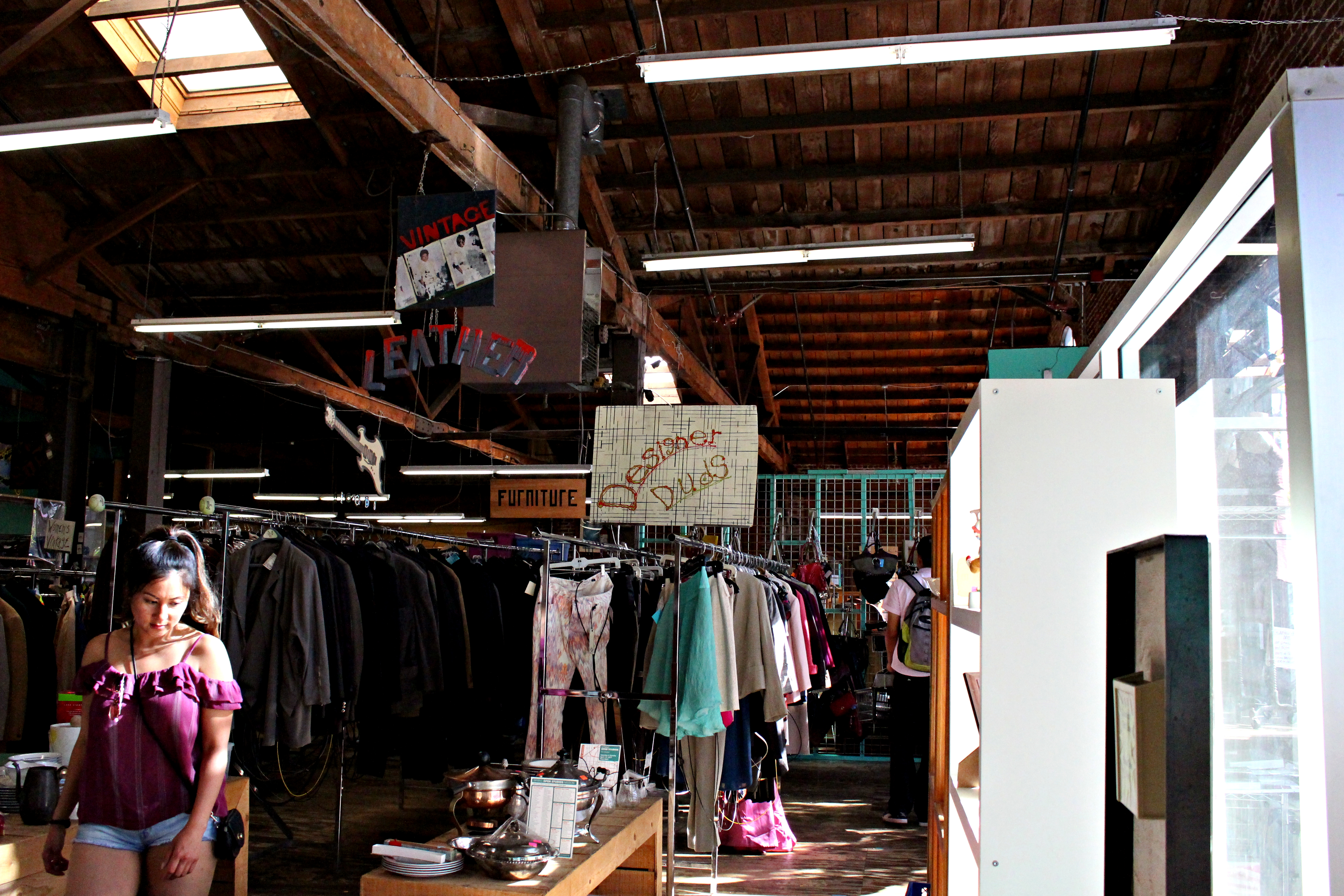 The thrift shop offers designer and leather sections. Credit: Fiona Belk / M-A Chronicle.