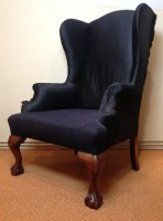 A late Victorian walnut wing armchair c 1890 in Georgian style
