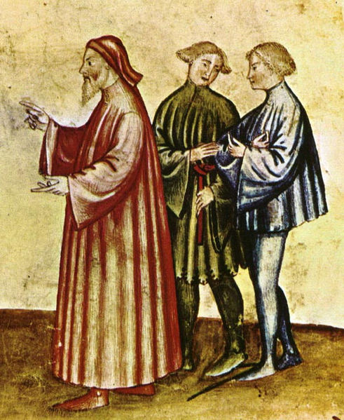 Older man (chiding an indiscreet young woman, see image below) wears a long, loose houppelande. The fashionable young men wear short tunics, one with dagged edges. The man on the right wears shoes with long pointed toes, late 1300s.