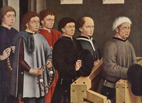 Lords with the bowl cut style in church. Typically for Germany, the highest status men (with kneelers) have fur (?) hats, whilst the sons with chaperons kneel on the floor.