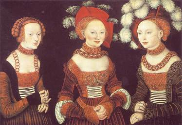 Three ladies in German fashion of 1525–30. Baretts with upturned slashed brims are worn over cauls, and sleeves are variously puffed, pieced, and slashed, with short wide cuffs extending over the hands.
