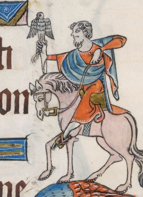 Man riding a horse wearing a long tunic and blue and red mantle