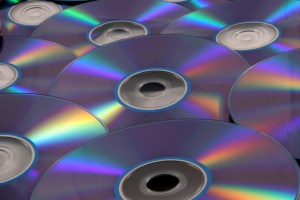 a pile of blank DVD discs