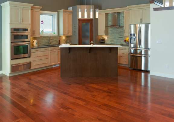 Interior design of modern kitchen in a new house with hardwood floors
