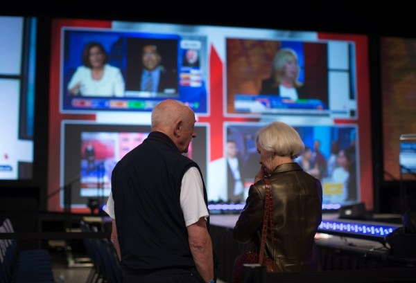 Conservative Party supporters watch early federal election ...