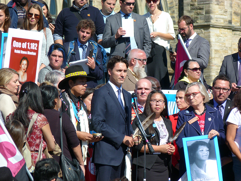 Prime Minister of Canada, Justin Trudeau, giving a speech on missing and murdered indigenous women in front of parliament in Ottawa, 4 October 2016 [CC BY-SA 4.0 (http://creativecommons.org/licenses/by-sa/4.0)], via Wikimedia Commons (Delusion23/Flickr)