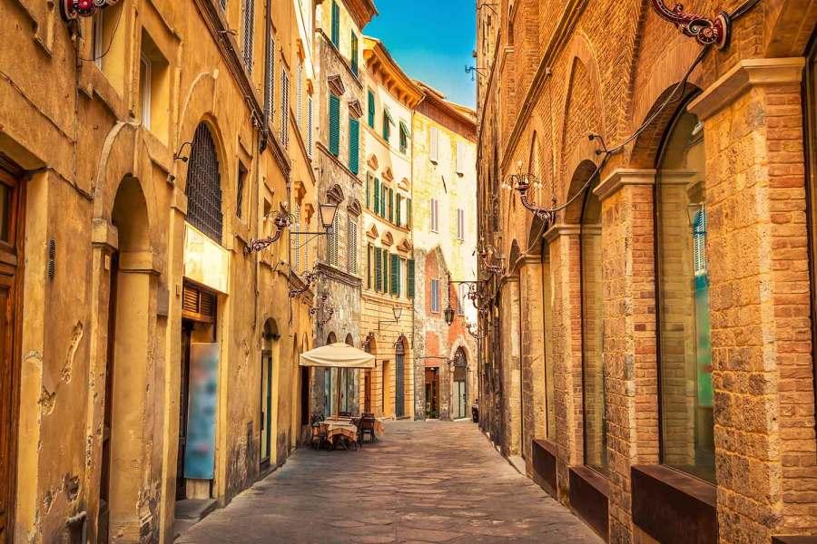 a narrow street in Siena