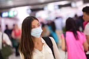 woman wearing surgical mask in airport