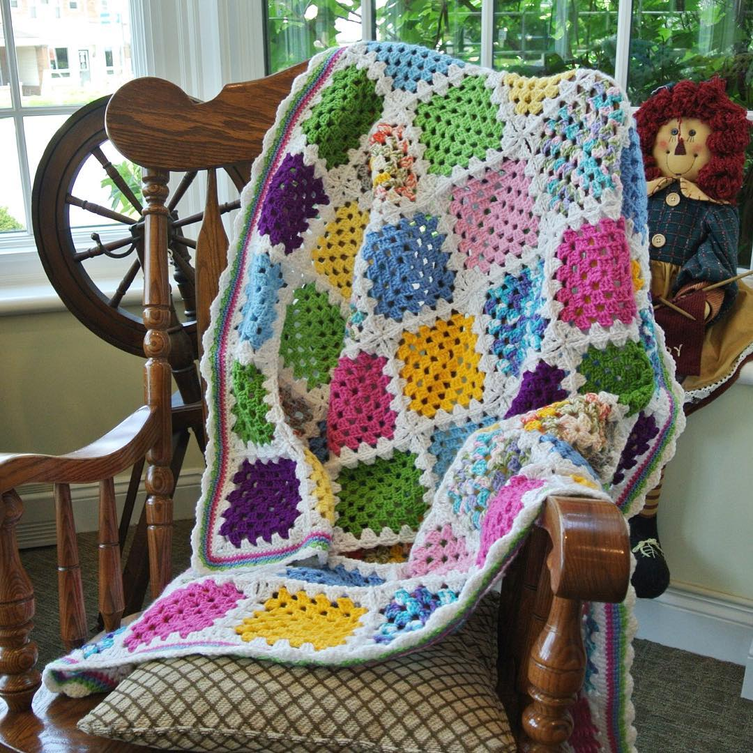 A granny square scrap-ghan assembled using the join-as-you-go slip stitch method