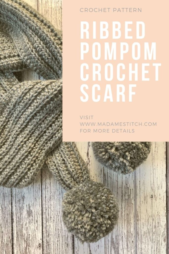 Ribbed Pompom Scarf | Crochet pattern by MadameStitch. A quick and easy crochet pattern, this scarf looks like a knit rib, worked lengthwise with attached pompoms. Made with Lion Brand Touch of Alpaca, a worsted weight. The perfect winter accessory. #madamestitch #crochetpattern #crochetscarf