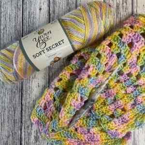 An image of Yarn Bee Soft Secret Ombre yarn for the Premie Lovey crochet pattern by MadameStitch
