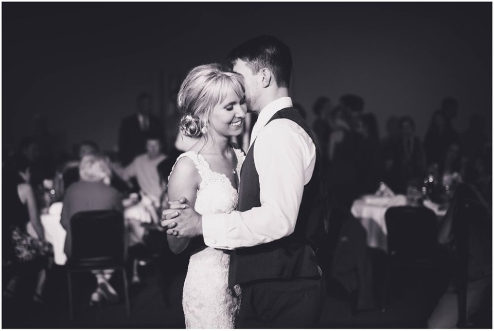 Bride and groom embrace during first dance | Maddie Peschong Photography