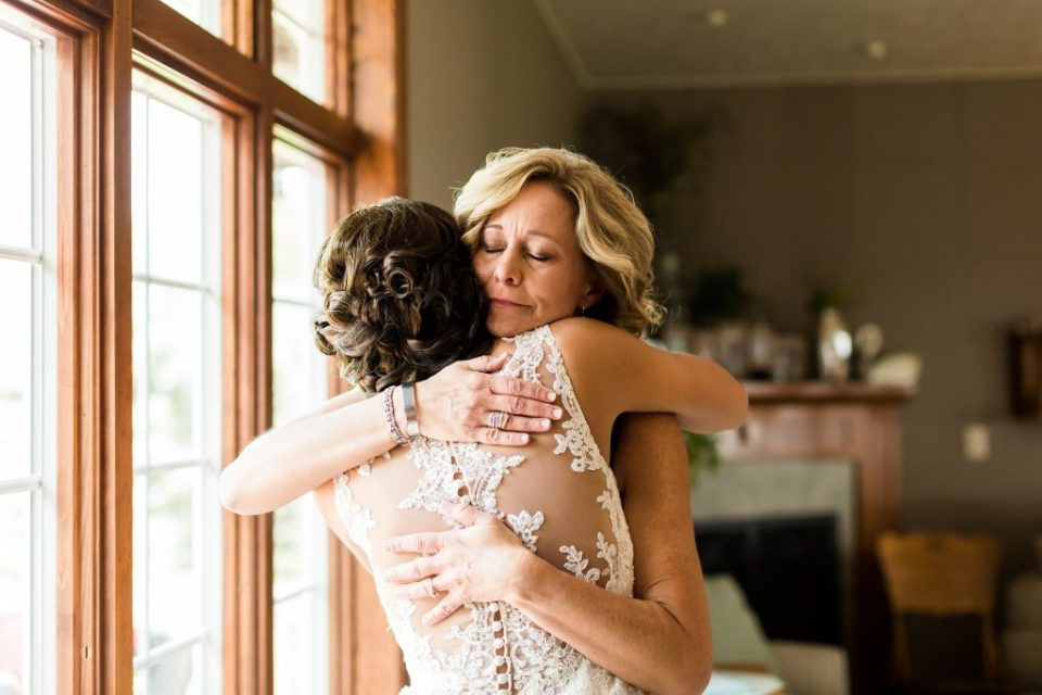 Mother and daughter embracing on wedding day. Maddie Peschong Photography.