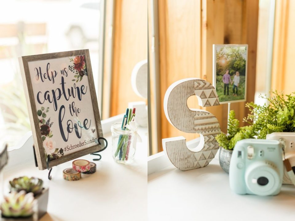 Polaroid guest book with 'Capture the Love' sign. Maddie Peschong Photography.