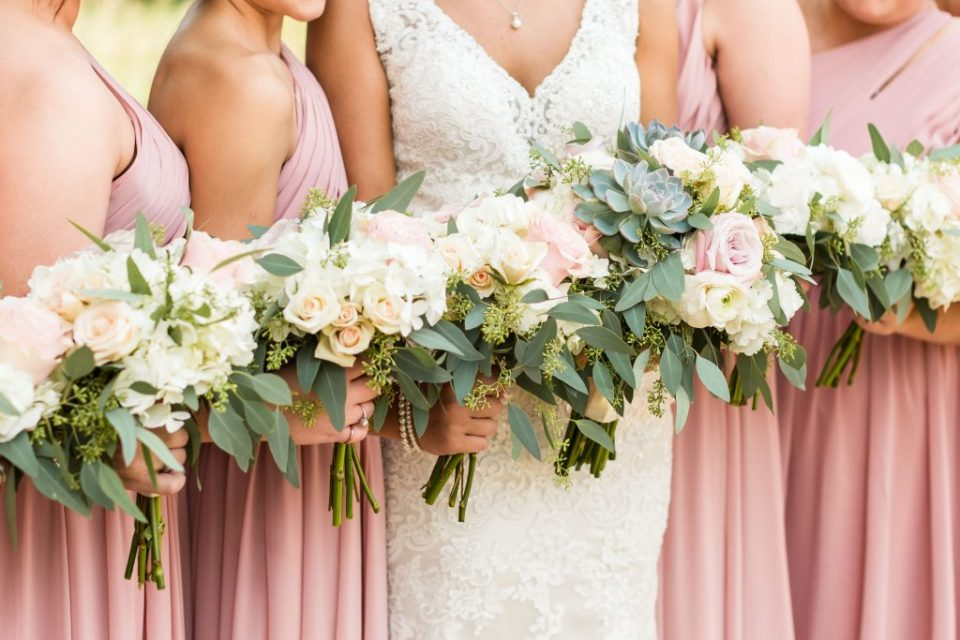 bridesmaids holding pink bouquets