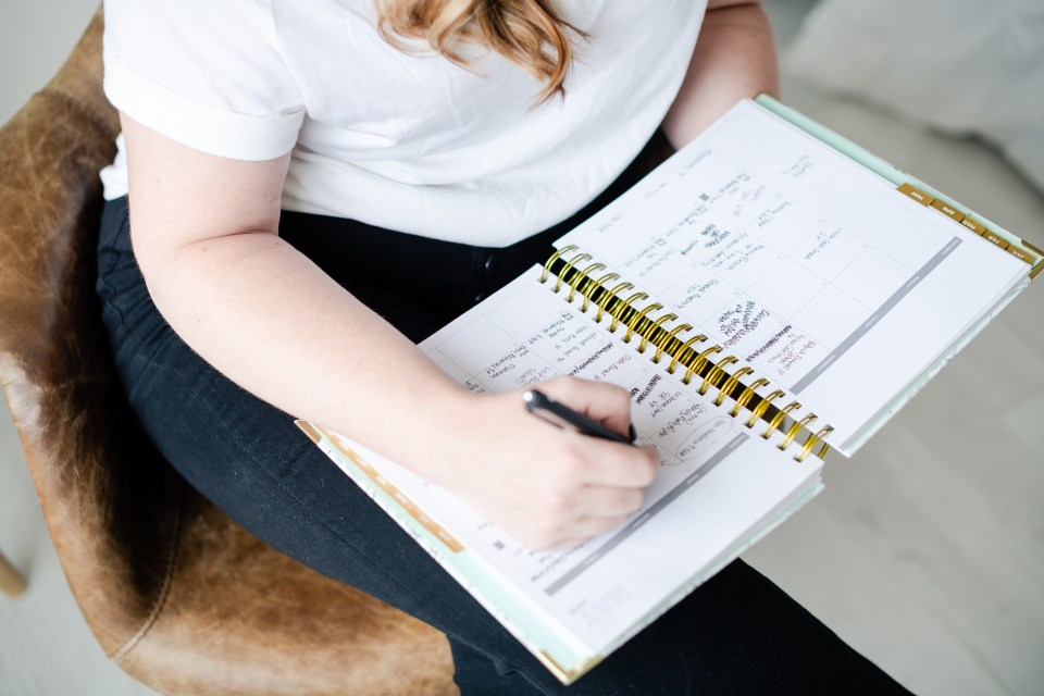 woman writing in planner personal branding session