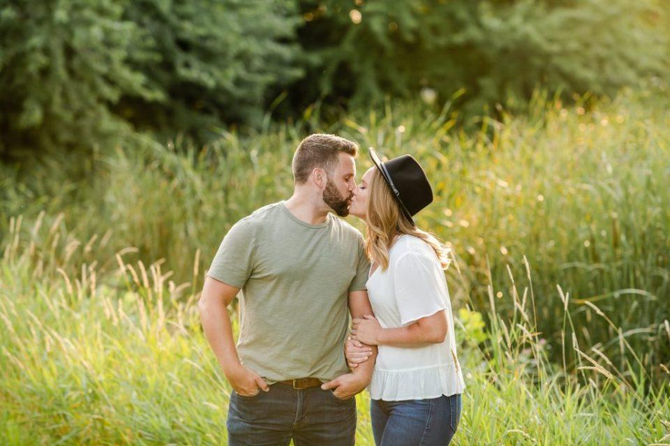 couple kissing at sunset sertoma park