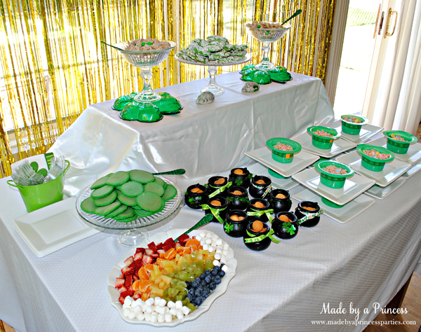 Kids St Patricks Day Party Ideas table with snack mix and Lucky Charms and green mini pancakes
