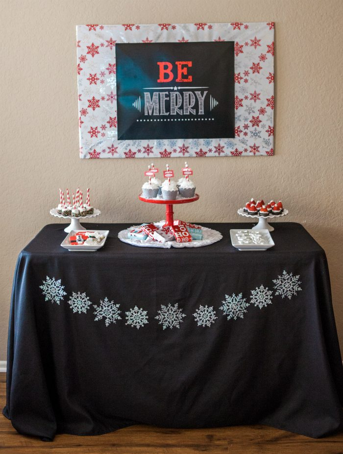 candy cane lane christmas party dessert table with sign