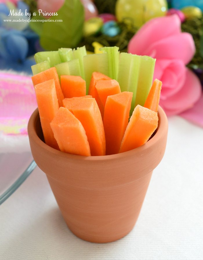 budget friendly easter ideas carrots in celery in clay pot