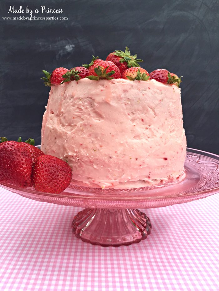 strawberry lemonade cake cream cheese frosting on cake plate