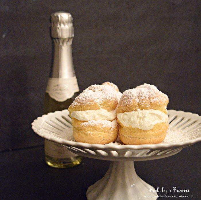 easy-champagne-cream-puffs-recipe-with-powdered-sugar-light-and-airy-puffs-with-champs-on-the-side