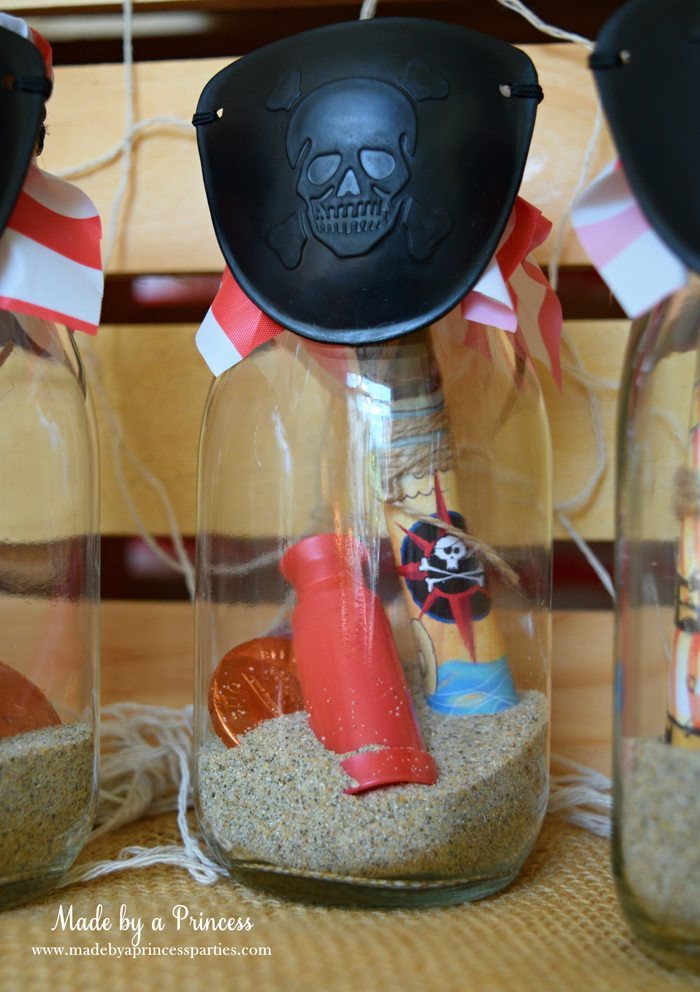 Pirate Bottle Invitations Party Idea fill bottom of glass milk bottle with sand add scope rolled invite coins and finish with eye patch