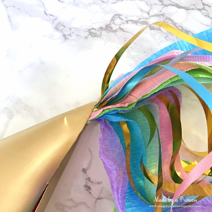 unicorn princess party hat idea tutorial view from the side once streamers are in place