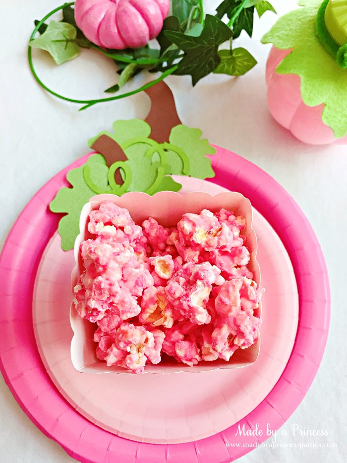 Pink Pumpkin Halloween Party Ideas pink popcorn in striped box Made by a Princess #pinkparty #pinkoween #pinkpumpkinparty