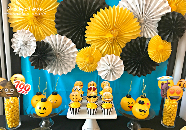 Emoji party ideas use yellow and black and white pinwheels to decorate