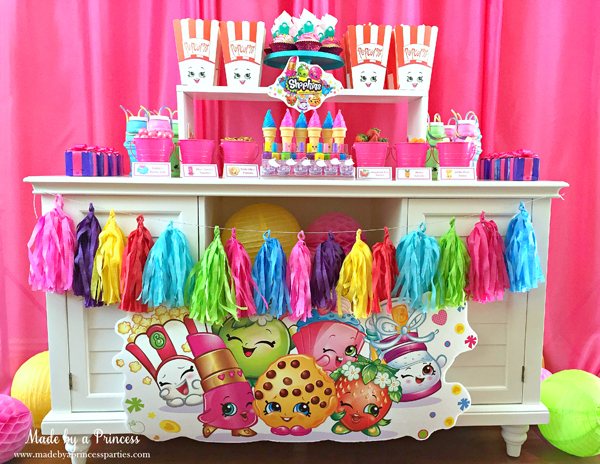 How to Make Tassel Garland with Crepe Paper shown in a Shopkins party