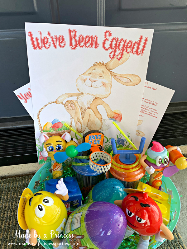 You've Been Egged Poem Printable Easter Activity basket of candy on the front porch