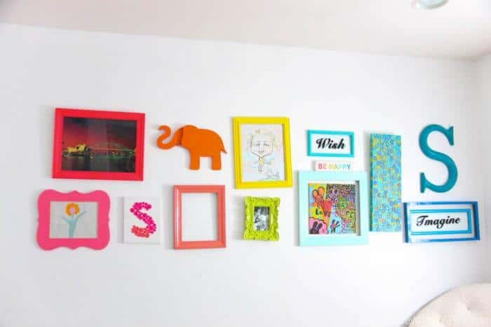 Rainbow Gallery Wall | Bright and colorful decoration ideas. Fun bright gallery walls | Colorful wall ideas | www.madewithhappy.com