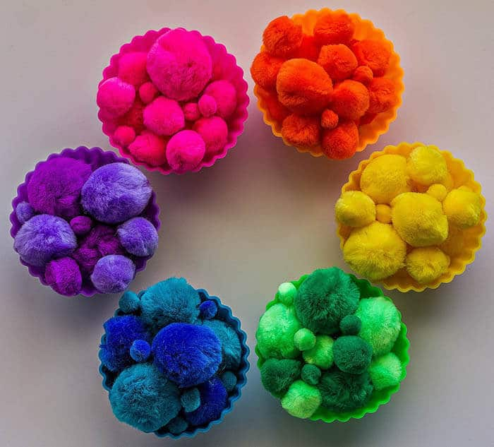Colorful Pom Poms | Rainbow Craft Supplies | Colorful Kids Crafts | All the craft supplies you need to keep you and your kids occupied for hours and hours. | Rainbow Popsicles, Rainbow Cupcake Wrappers, Rainbow Pom poms and more | www.madewithhappy.com