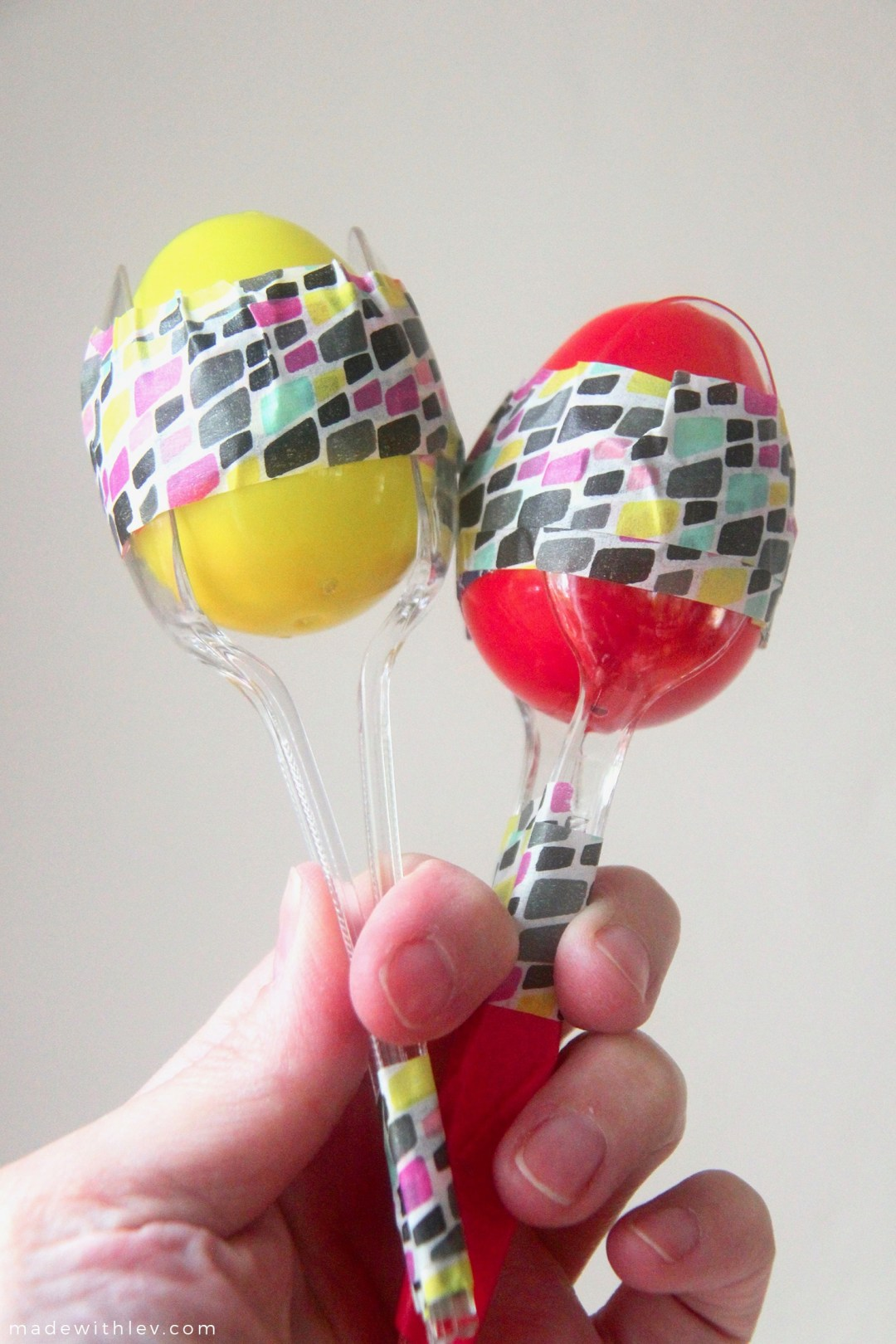 Plastic Egg Maracas for Cinco de Mayo | This project involves minimal supplies and (hopefully) ones that you have in your house already. It's also a really great project to have in your back pocket post-Easter since plastic eggs are seriously on sale.#musicalinstruments #toddlercrafts #sensoryplay #noisemakers #maracas #cincodemayo #partyfavor #partycraft #colorfulcraft #plasticeggs #kidscrafts #familycrafts #preschoolcraft