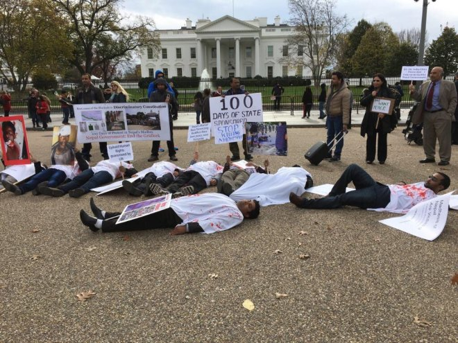 Protesters posed as corpses in front of White House. A symbolic move to mimic the brutal and extra-judicial killing of unarmed Madhesis. Photo by: Pradeep Thapa