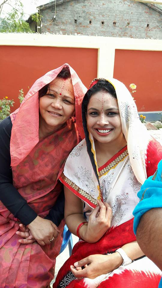 """Ladies in the picture are my Bhabhi Abha Mishra and my dear wife Sangeeta Mishra.....both in Ghunghat or Ghogh (in maithili) which our first woman chief justice hates.....I don't know about achievements of female members of CJ's family but both my Bhabhi and wife came from India, struggled and now are professionally at the level that many pure """"Nepali"""" women will envy......"""