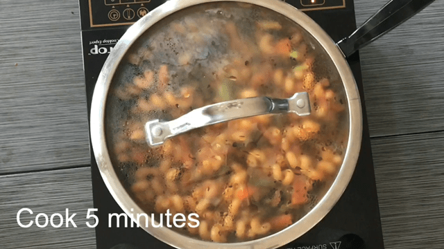 Pasta with vegetables in tomato sauce