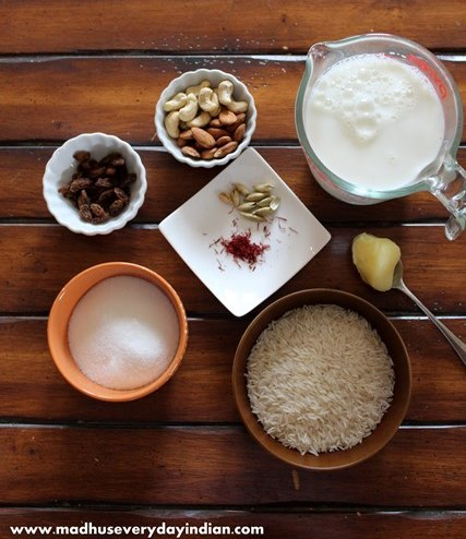 rice kheer ingredients- milk, rice, sugar, ghee, nuts, cardamom and saffron