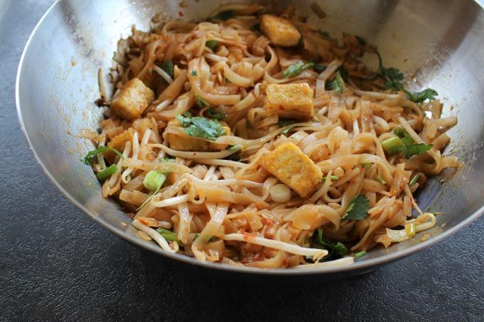 pad thai noodles in a wok