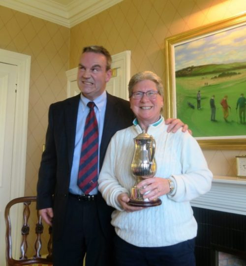 Stuart McEwen, secretary of HCEG, feels the pain of handing the trophy to winning 2016 Captain, Jane Connachan