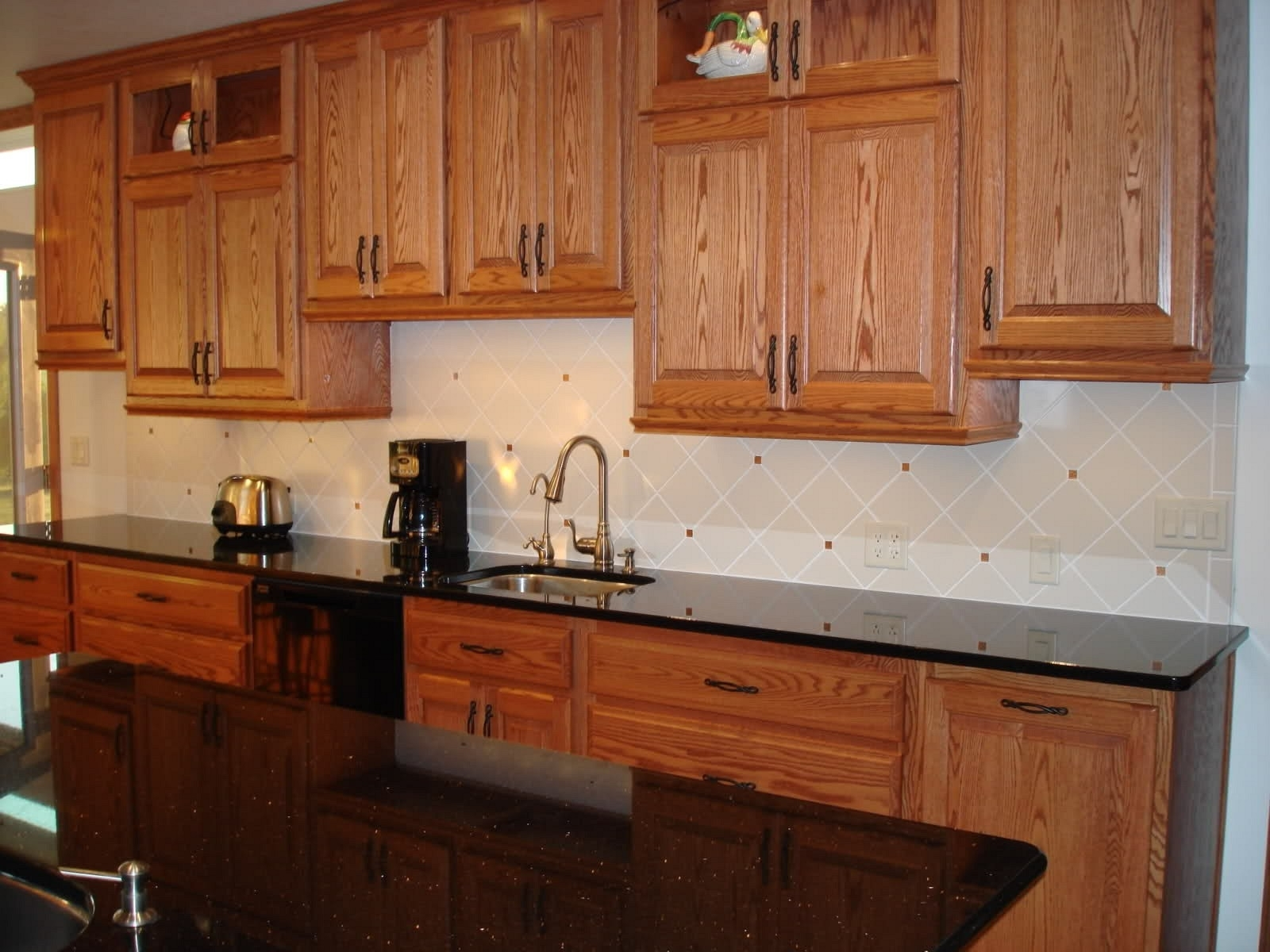 Honed Black Granite Countertops Pros And Cons - Madison ... on Dark Granite Countertops With Dark Cabinets  id=67075
