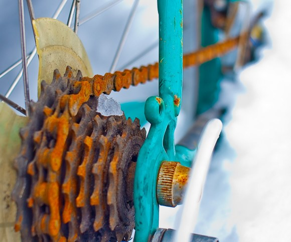 Rusty chain on a turquoise frame