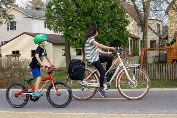 Family on biking on path