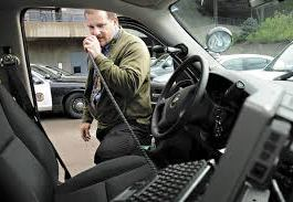 Police Officer speaking 10-code into radio